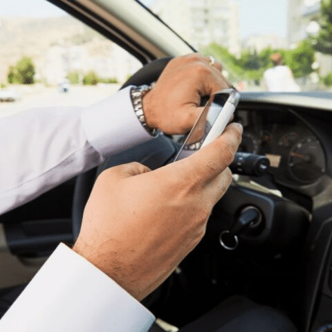 MPs propose to ban all hands-free devices in cars