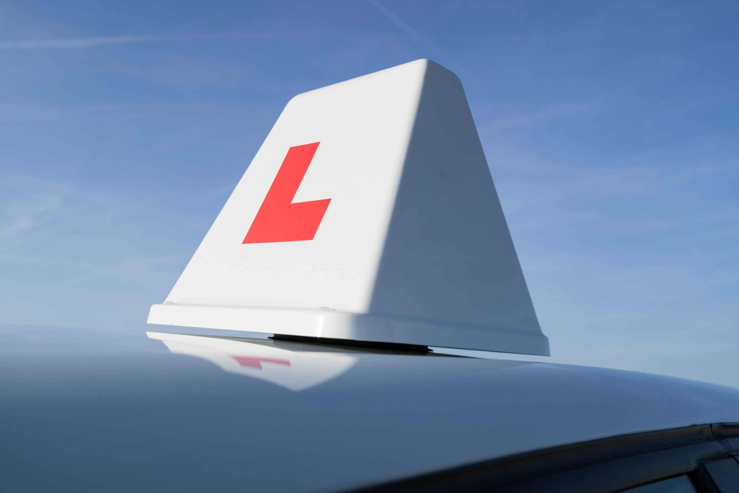 Learner driver sign on top of car